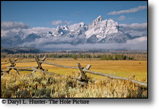 Buckrail fence, snow capped mountains, Grand Tetons, Grand Teton Park, Wyoming