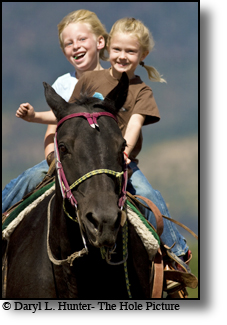 Girls galloping with joy on horse