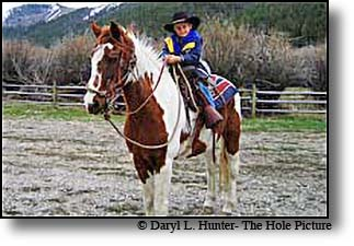 Kid riding horse, Pinedale Wyoming
