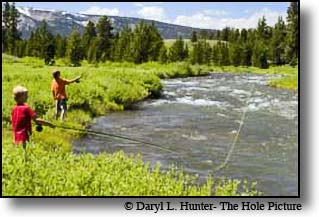 kids fly-fishing the Gardiner River in Yellowstone National Park